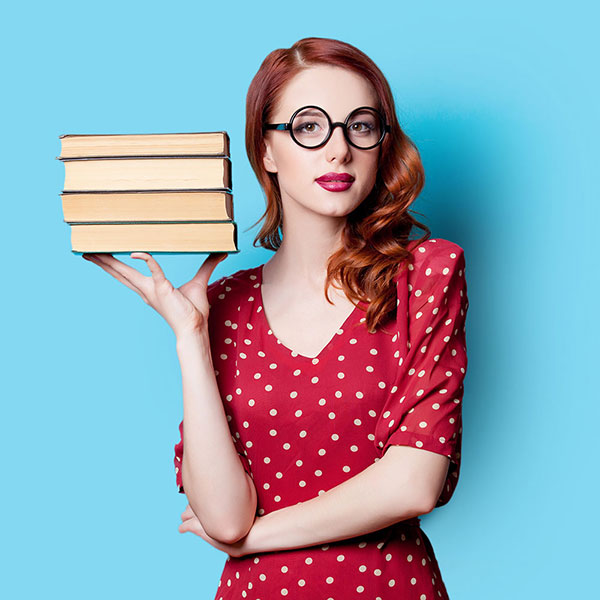 Retro woman holding stack of books